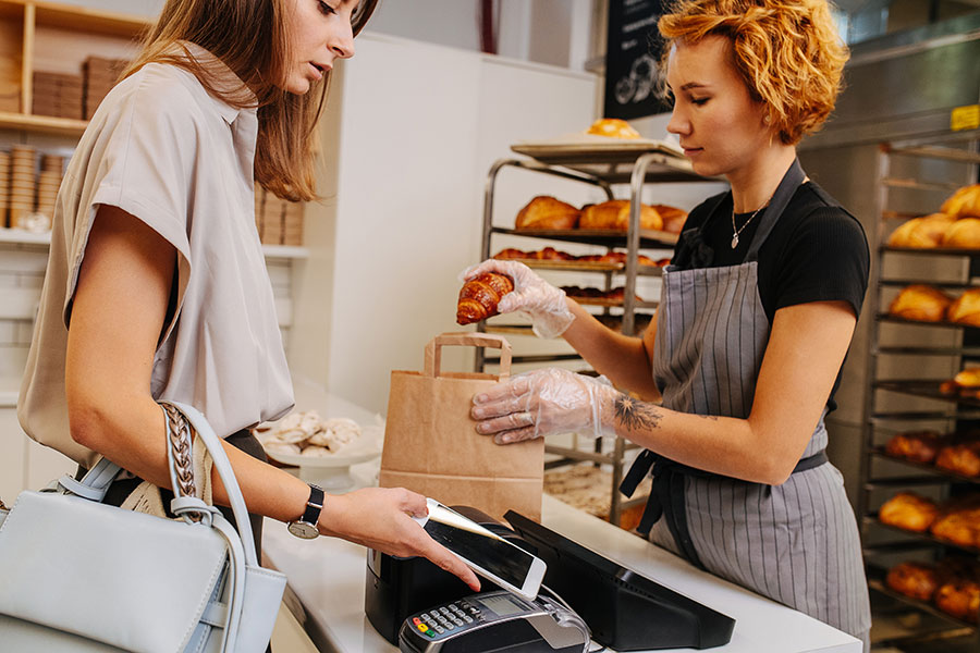 Woman buying from a local bakery